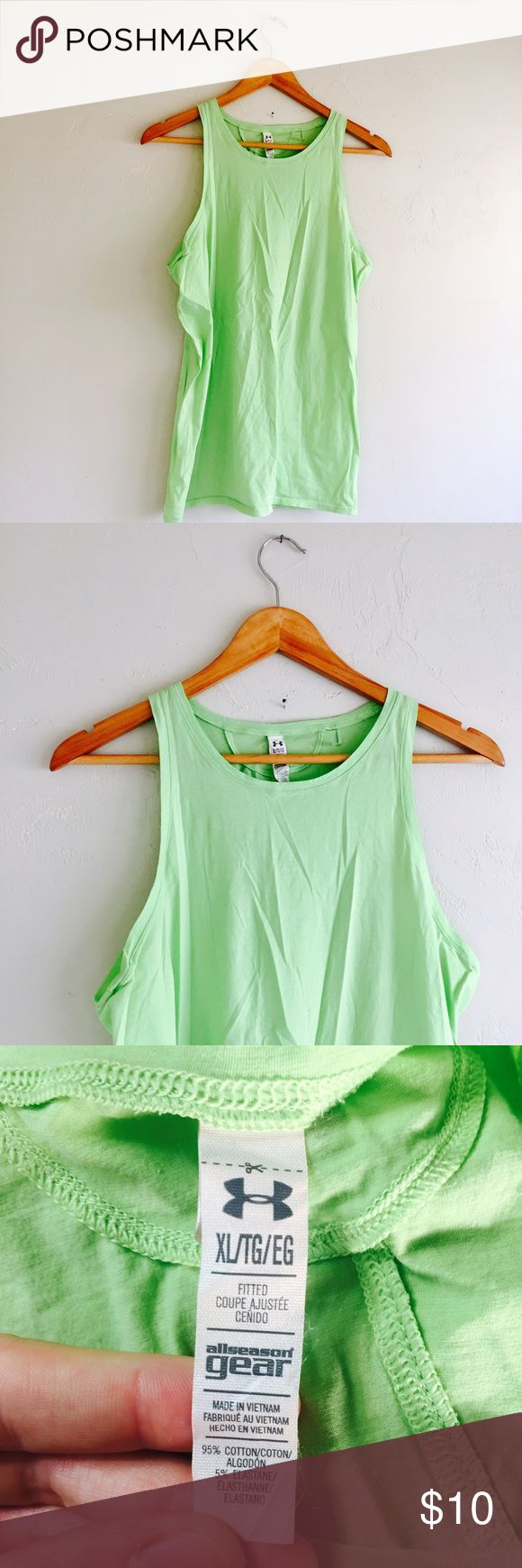 Under Armour Shirt Lime Green Tank Top Fitted XL Under Armour Shirt Lime Green Tank Top Fitted  Cotton elastane blend  Size Extra Large XL  Heat Gear all season gear  Small hole near neck, shoulder. See pictures Under Armour Tops Tank Tops