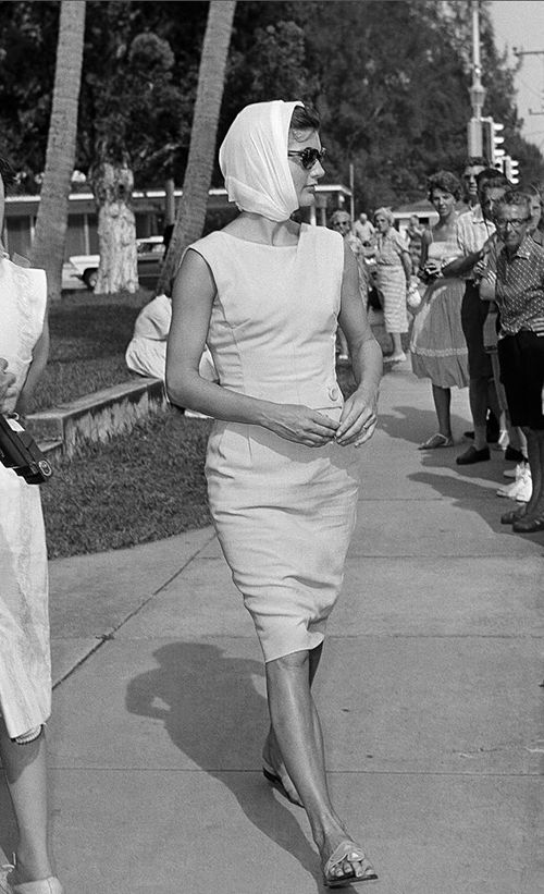 Jackie Kennedy sporting the famous Jack Rogers sandals and a lovely scarf bonnet. A style she wore often. #modcloth #styleicon