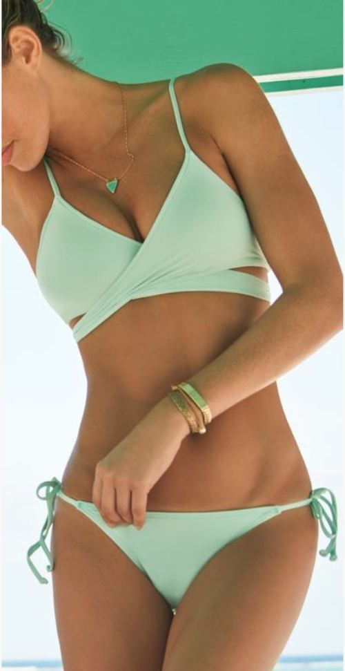 If you love green, this is the bathing suit for you! For makeup that will go great with your green eyes, visit Beauty.com.