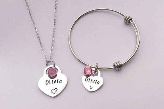 Personalised girls jewellery - personalized girls jewelry - daughter gift present- personalized jewelry - personalised childrens jewellery  This is the perfect jewellery set for a young girl.  It is made from a stainless steel heart measuring 20x23mm which is stamped with the name of your choice and finished with a swarovski crystal birthstone of your choice.  It is hung on a 16 stainless steel chain.  It is complemented with a stainless steel childs adjustable bracelet which has a heart…