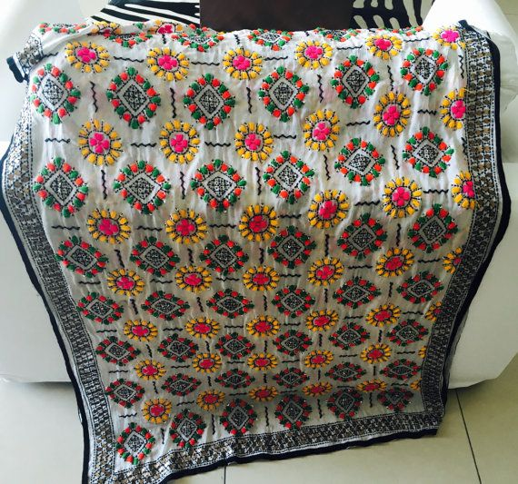 Vintage Hand Embroidered Indian Dupatta Phulkari Shawl, colorful and versatile. Could be used for many occasions and in many ways and can give to any of your outfits special sophisticated and personal touch! Available in many colors and patterns. Beautiful sequins and thick stitches of thread embroidery are done by hand in floral and paisley design. Border of the stole is beautifully decorated with mirror sequins and thread embroidery work, which makes it look more attractive. FABRIC…