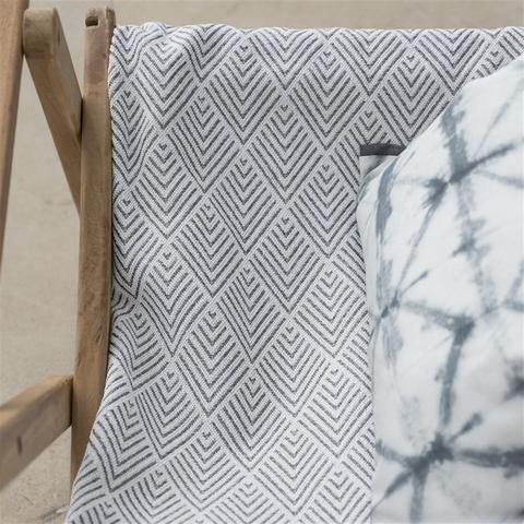 A smart textured weave with a graphic chevron pattern woven in durable polypropylene for exterior use - solution dyed yarns for great colour fastness and all the practical needs for your outdoor schemes from poolside to garden. Great for all exterior cushions, seating and sun loungers | Buy online