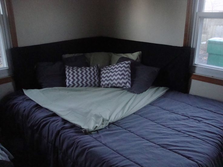 If you have your bed pushed to a corner of your room due to space restrictions, make your own corner head board! This makes a small bedroom look beautiful, and allows you to keep your bed in the corner without it looking awkward. #SmallSpaceSolutions #SmallBedroom