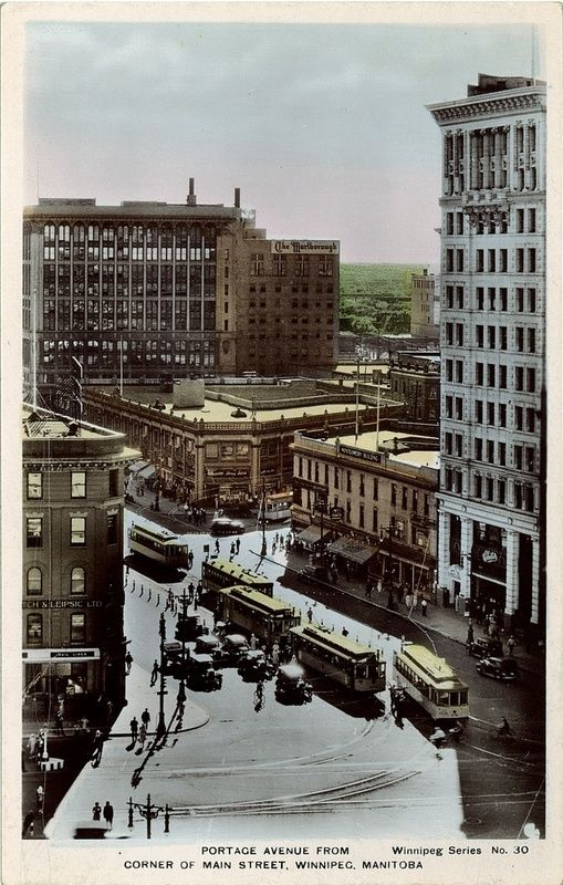 Portage Avenue from Main Street, ca. 1930--The Marlborough Hotel (pictured here in the centre of the photo) opened to the public on November 14, 1914 at 331 Smith Street. Just nine years later, the hotel had become so popular that a $400,000 extension was added to accommodate more guests. Today, the hotel remains one of Winnipeg's most historic and elegant buildings.