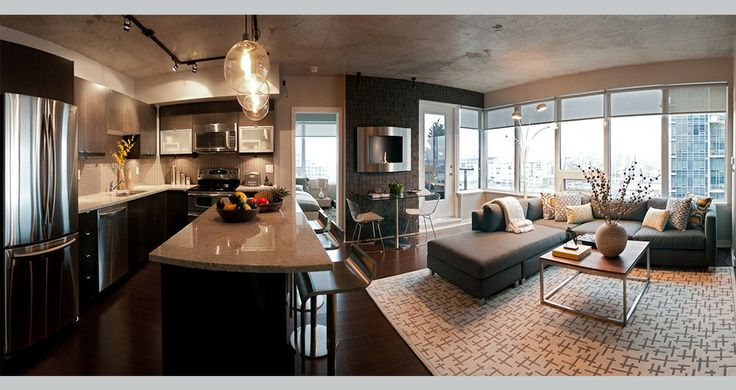 Fia Interiors Condo Design with custom fireplace wall, custom sectional and toss cushions. Coffee table produced by GarageStyle.