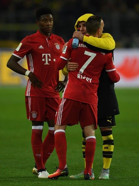 Bayern Munich's French midfielder Franck Ribery, Bayern Munich's Austrian midfielder David Alaba chat with Dortmund's midfielder Mario Goetze after the German first division Bundesliga football match of Borussia Dortmund vs Bayern Munich in Dortmund, western Germany, on November 19, 2016. / AFP / PATRIK STOLLARZ / RESTRICTIONS: DURING MATCH TIME: DFL RULES TO LIMIT THE ONLINE USAGE TO 15 PICTURES PER MATCH AND FORBID IMAGE SEQUENCES TO SIMULATE VIDEO. == RESTRICTED TO EDITORIAL USE == FOR…