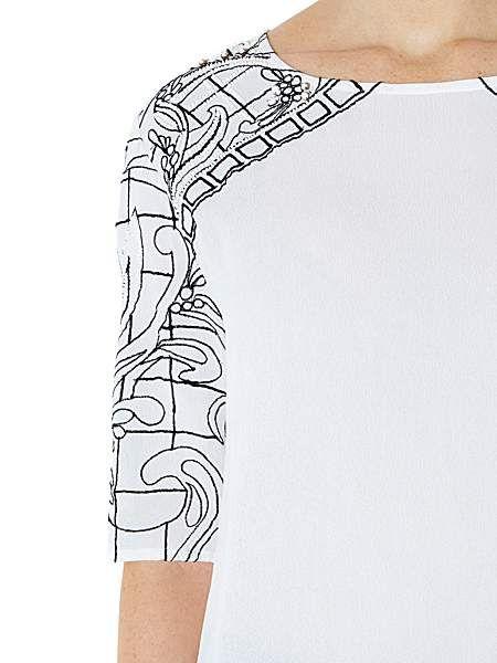 Embroidered split back top