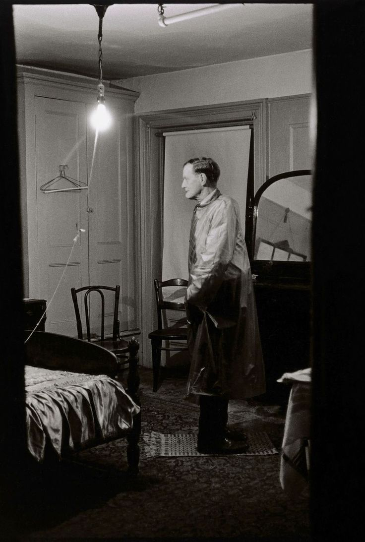 """Exhibition - Diane Arbus: in the beginning' at the Metropolitan Museum of Art, New York. """"All of her photographs are intelligent investigations of the human condition which produce and empathic response in the viewer."""" Photo by Diane Arbus. 'The Backwards Man in his hotel room, N.Y.C. 1961'."""
