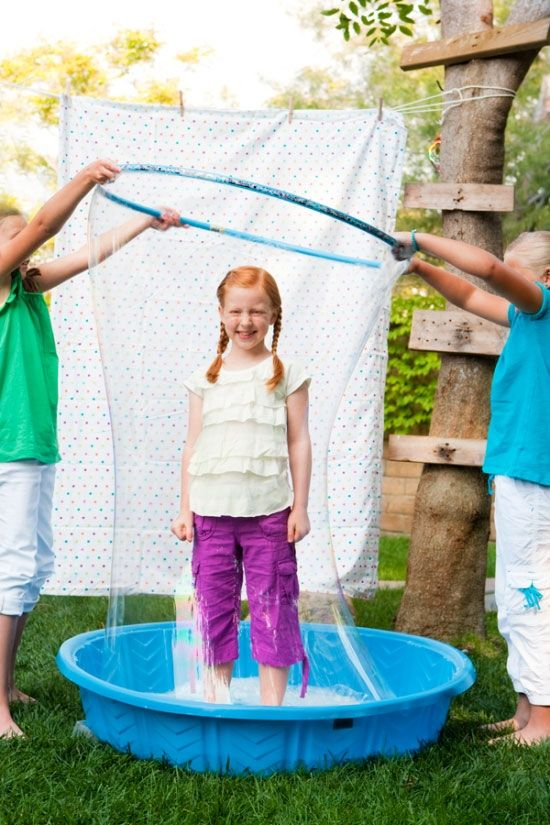 wading pool + hula hoop + LOTS of bubble solution lets you put a person inside a bubble, just like at the science museums