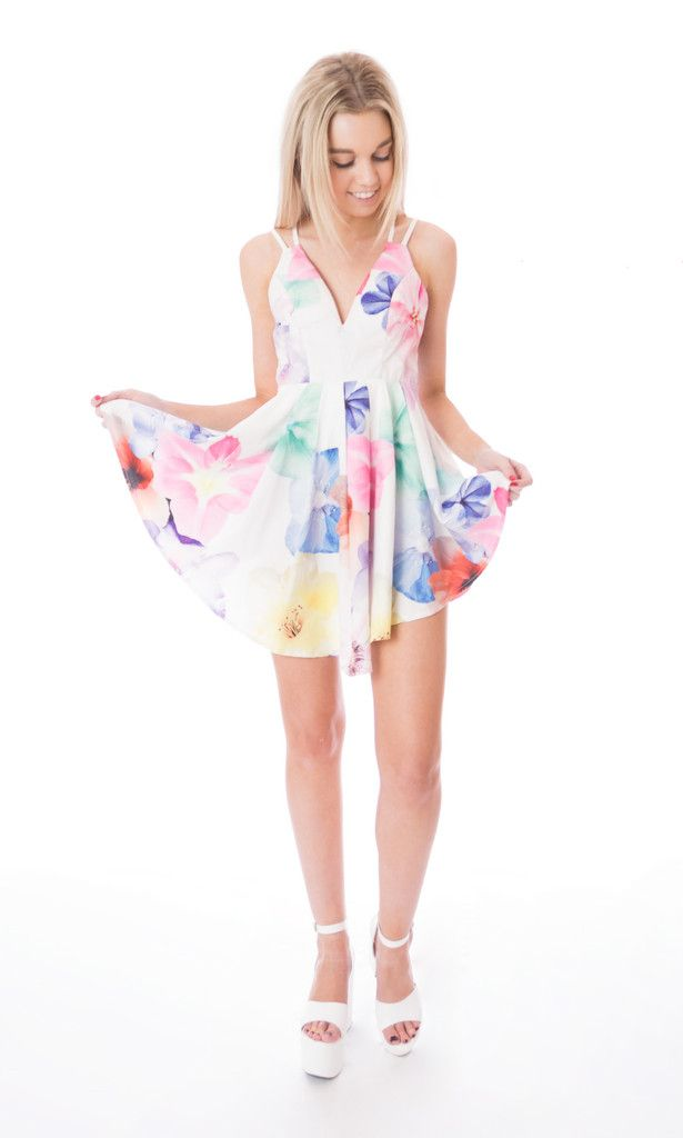 white floral curved hem dress Click to buy now