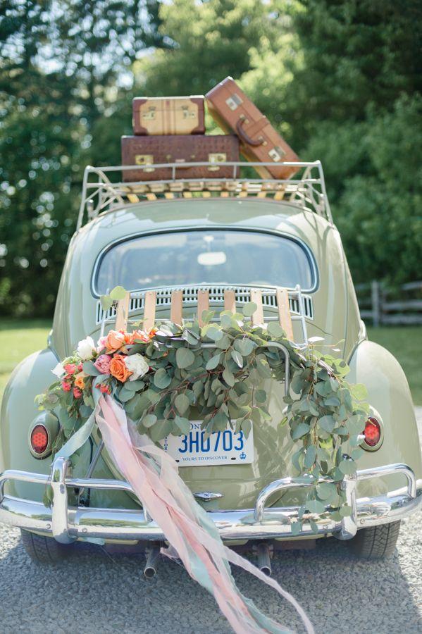 A pretty vintage getaway car: http://www.stylemepretty.com/canada-weddings/2016/02/04/peaches-cream-wedding-inspiration/   Photography: Krista Fox - http://kristafox.com/