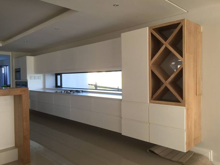 Modern white kitchen combined with white washed Oak veneer