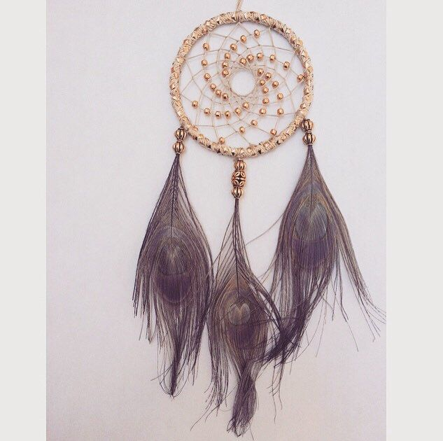 A personal favorite from my Etsy shop https://www.etsy.com/listing/233124585/small-gold-peacock-feather-dream-catcher