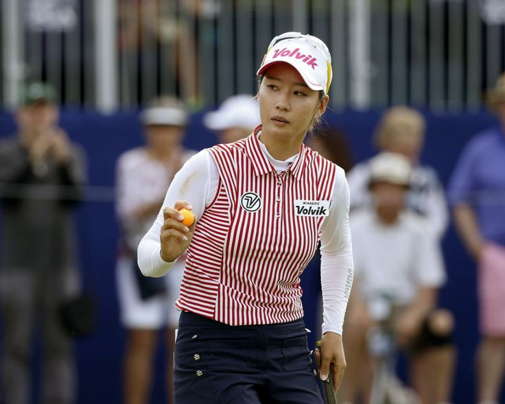 Chella Choi, of South Korea, acknowledges the gallery after making birdie on the 18th green during the third round of the Women's PGA Championship golf tournament at Olympia Fields Country Club, Saturday, July 1, 2017, in Olympia Fields, Ill. (AP Photo/Charles Rex Arbogast)