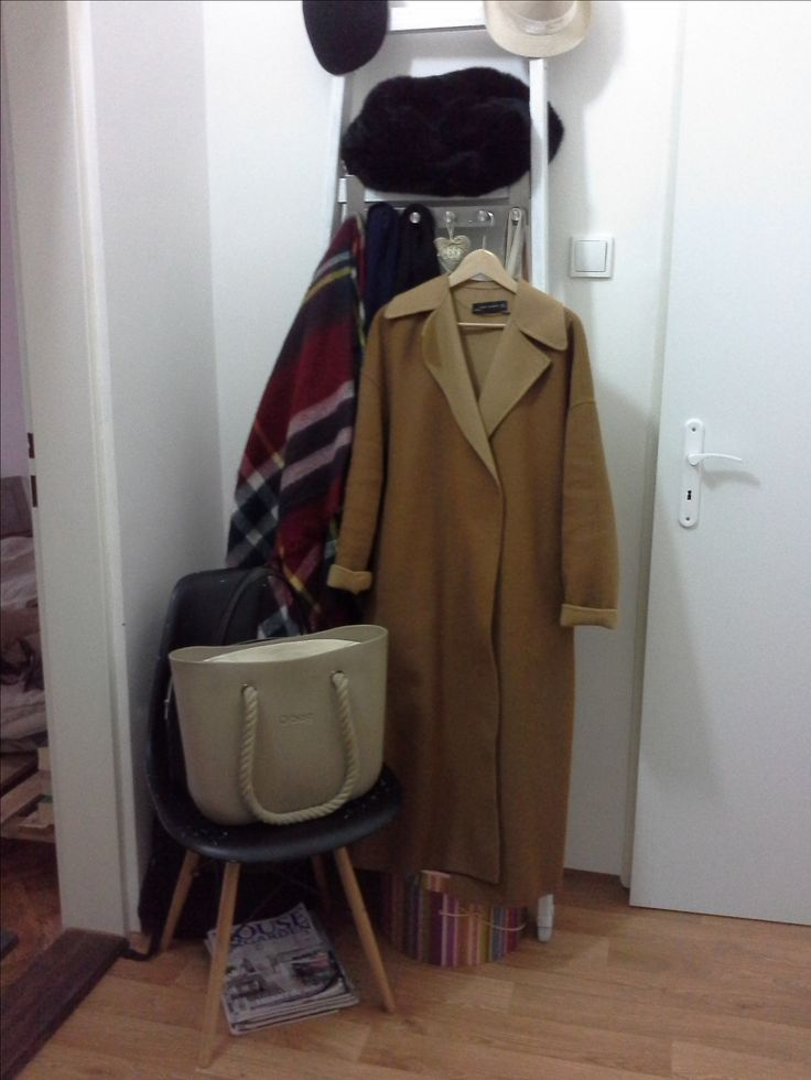 ...finding a new purpose to an old ladder - sanded and repainted, one half used as a coats rack, other one for shoes...