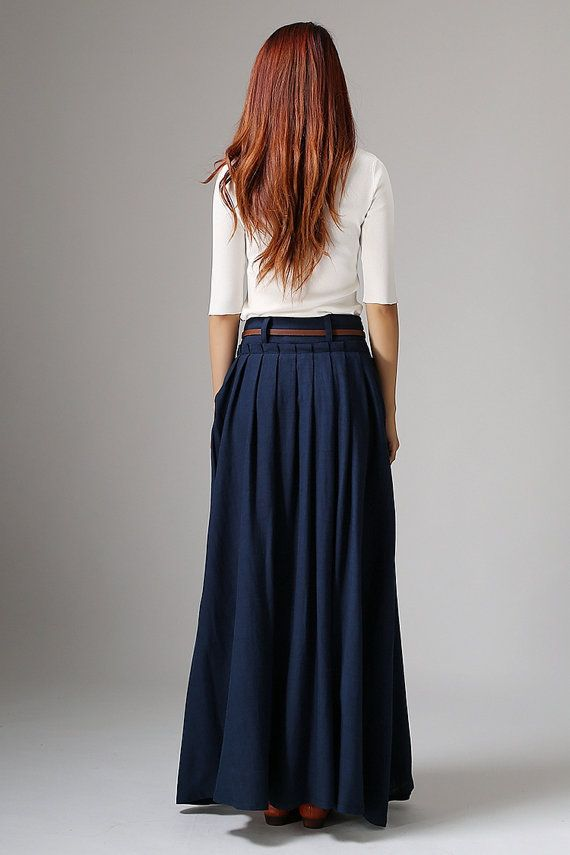 Get dressed and out of the door in classic good looks with this navy blue pleated skirt. The crisp pleats drape nicely all day long to keep your look perfect. This is a very easy to style maxi skirt and adding simple accessories will create a great look.  Navy blue is a great color to add to your wardrobe and will match everything you own. Youll be able to grab this skirt for just about any occasion whether out shopping or lunch with your girlfriends, youll always look on trend.  The long…