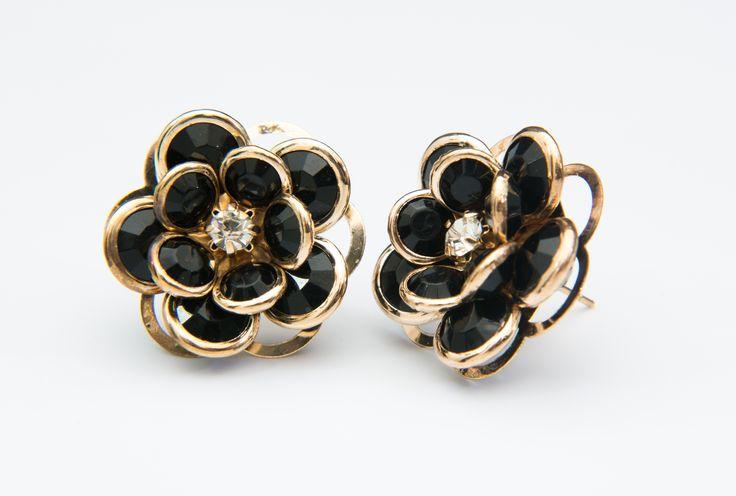 Aretes en EL TESORO: Flores (negras).