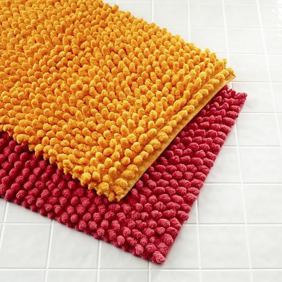 The Land of Nod | Kids Bath Accessories: Pink and Orange Bath Mats in Bathroom Décor