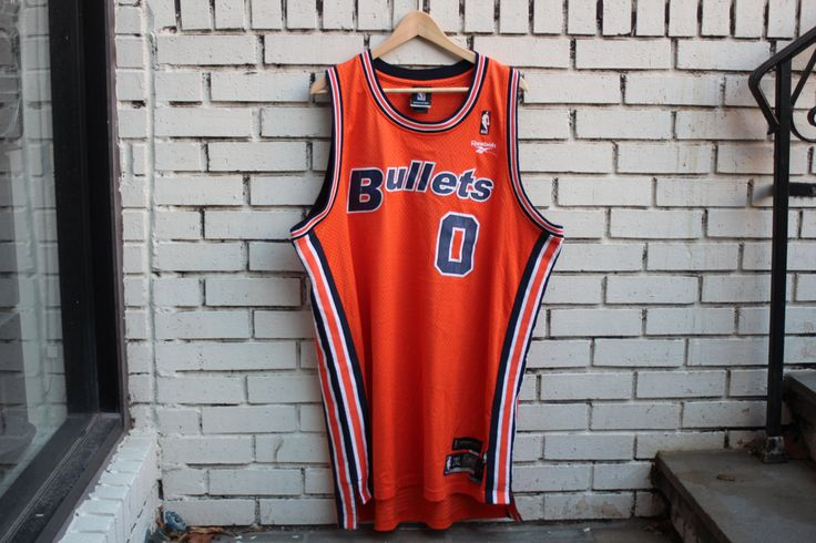 Up for sale is a vintage WASHINGTON BULLETS Jersey. #0 Gilbert Arenas. Reebok tag. Officially licensed by the NBA. Overall in great vintage condition!  Since all sizing is different, please see our measurements below to ensure a proper fit.  Approximate Flat Measurements: Pit to Pit (across front about 1 down from pit seams): 23 3/4 Top to Bottom (where tag meets neck collar to front bottom): 28 1/4  Feel free to ask any questions. If youre in Washington, D.C., stop by our retail lo...