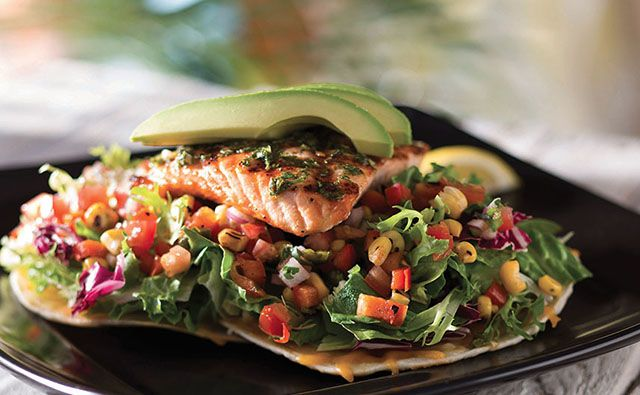 Enjoy entrée salads at Bahama Breeze like the Grilled Salmon and Mixed Greens on a Tostada