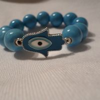 Hamsa Hand Bracelets Turquoise Hamsa Hand Bracelet made with ceramic beads Price R150.00  #hamsahand #evileye #hamsa #bracelet #beads #isaacsjewellery