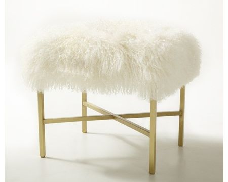I was thinking something similar to this would be fun for the brown leather chair. This is too expensive, but I think with a faux fur throw and an ottoman or small table topped with foam this would be a totally easy DIY: