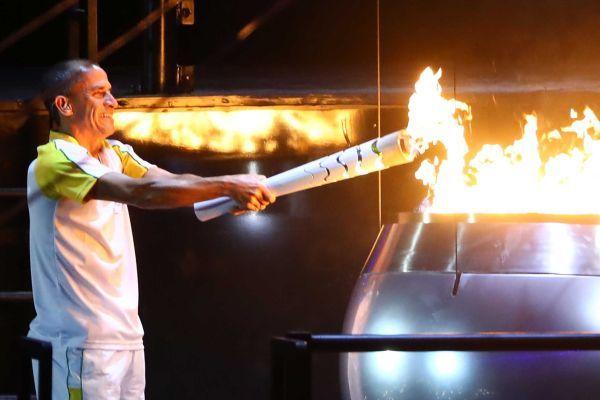 Former athlete Vanderlei de Lima lights the Olympic