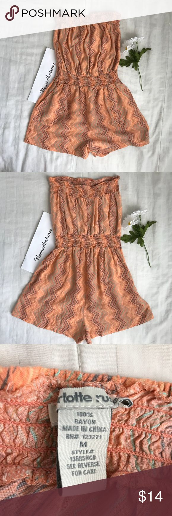 Charlotte Russe Peach Strapless Romper Peach strapless romper with zig zag printing. Ask for measurements if needed :) 🌼 Charlotte Russe Dresses Strapless