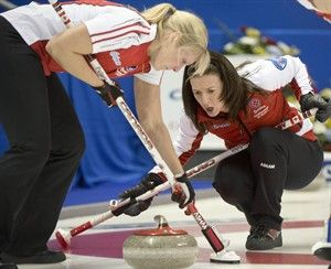 Team Canada skip Heather Nedohin, right, and Laine Peters guide in a rock during curling action against New Brunswick at the Scotties Tournament of Hearts in Kingston, Ont., on Saturday, February 16, 2013. THE CANADIAN PRESS/Ryan Remiorz  THE CANADIAN PRESS/RYAN REMIORZ