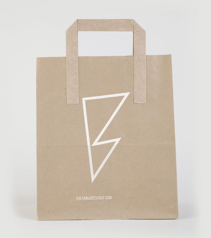 Logo and uncoated, unbleached bag with white ink finish for children's fashion brand The Fableists designed by Freytag Anderson.
