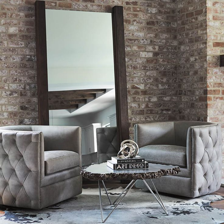 Corner comfort create an inviting alcove in your homes living area with a pair of palazzo leather swivel chairs