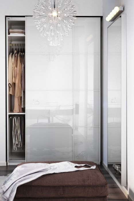 Sliding glass doors on your PAX wardrobe look sleek and modern, and they're great for tight spaces because you don't need any extra room to open them.