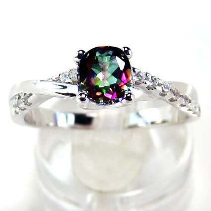 Rainbow Topaz and White Zircon gemstone ring. The setting is Sterling Silver.