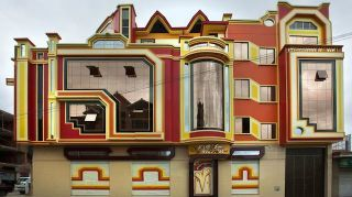 """These strangely decorated, brightly-colored buildings in El Alto, Bolivia, are the early examples of a new Bolivian architectural style, started after the election of President Evo Morales Ayma in 2006, when the national pride became more important than ever. Appropriately, they are called cohetillos — """"spaceships."""""""