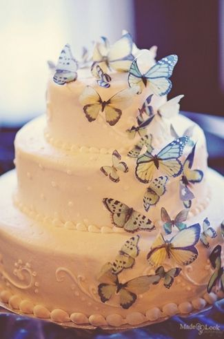 {DIY Tip} Purchase a few beautiful nylon butterflies or print and snip the DIY Vintage Butterfly Printable provided previously and display on your wedding cake. - 21 DIY Butterflies Wedding Theme & Ideas | Confetti Daydreams