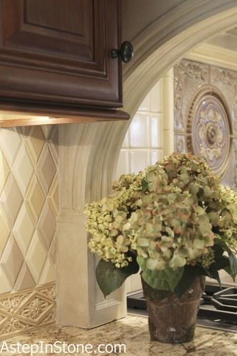 Beautiful Backsplash Detail tile at the base, 3-d harlequin tile arch transition.