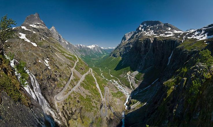 Trollstigen (English: Trolls' Ladder) is a serpentine mountain road in Rauma, Norway, part of Norwegian National Road 63 connecting Åndalsnes in Rauma and Valldal in Norddal. It is a popular tourist attraction due to its steep incline of 9% and eleven hairpin bends up a steep mountain side. Trollstigen was opened on July 31, 1936, by King Haakon VII after 8 years of construction. During the top tourist season about 2,500 vehicles pass daily.