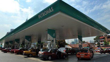 Malaysia cuts subsidies on fuel