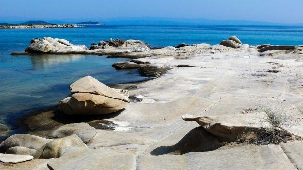 Stone sculptures at Vourvourou beach