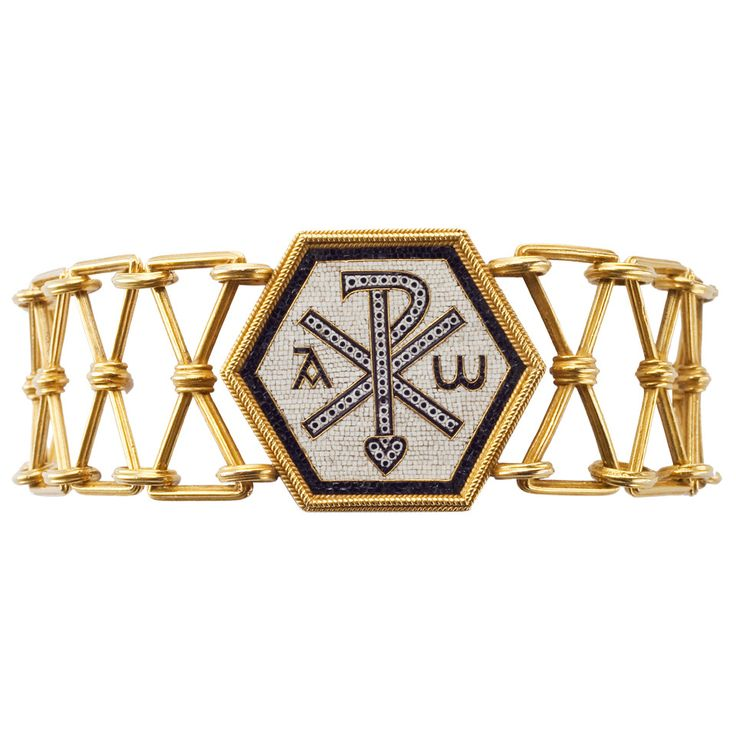1860s Castellani Gold and Micromosaic Bracelet. Byzantine Revival gold bracelet with a central piece in micromosaic depicting the Chi-Rho symbol.  Signed with interlaced C's