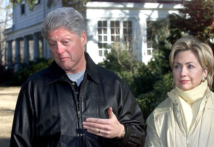 US President Bill Clinton (L) talks about the first night with First Lady Hillary Rodham Clinton in their new $1.7 million USD Dutch colonial home 06 January, 2000 in Chappaqua, New York. The First couple answered questions from local and national media ranging from what they did over night to gays in the military. (ELECTRONIC IMAGE) AFP PHOTO/TIM SLOAN (Photo credit should read TIM SLOAN/AFP/Getty Images)