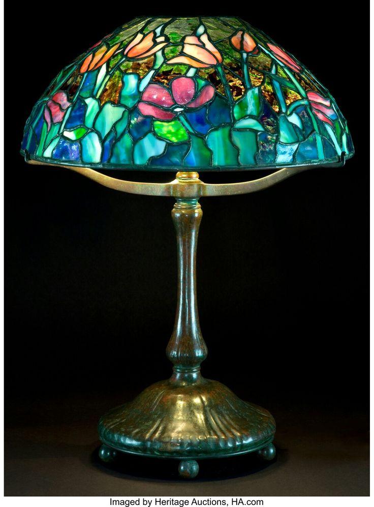 A TIFFANY STUDIOS PATINATED BRONZE LAMP WITH TULIP GLASS SHADE Tiffany Studios Corona New York Circa 1900 Marks To Base NEW YORK