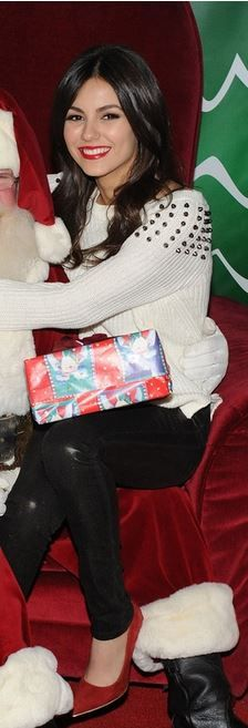 Who made Victoria Justice's white studded sweater, red suede pumps, black leather skinny pants?