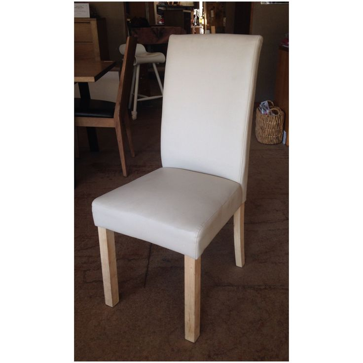 The High Back Leather Bond Dining Chair For Sale At Wildflower Furniture.  Available In A