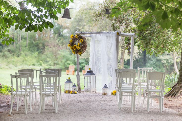 Rustic wedding ceremony decoration with sunflowers in the garden