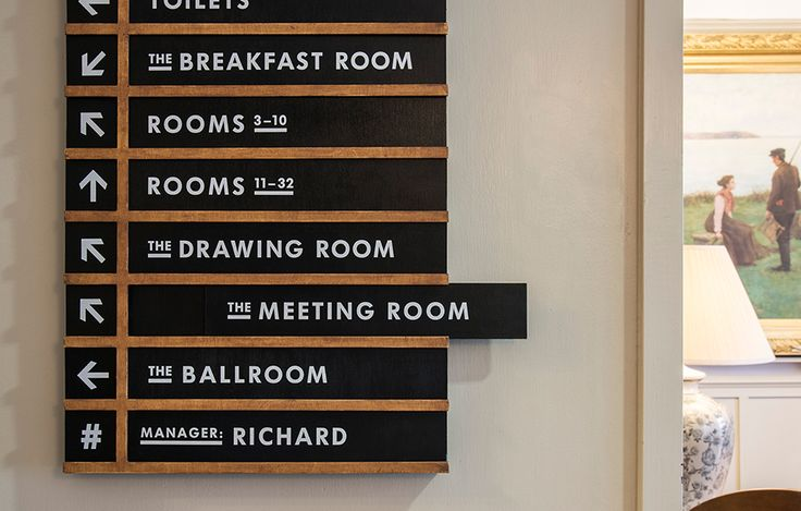 graphic design signage identity monochrome giants causeway national trust thomas matthews
