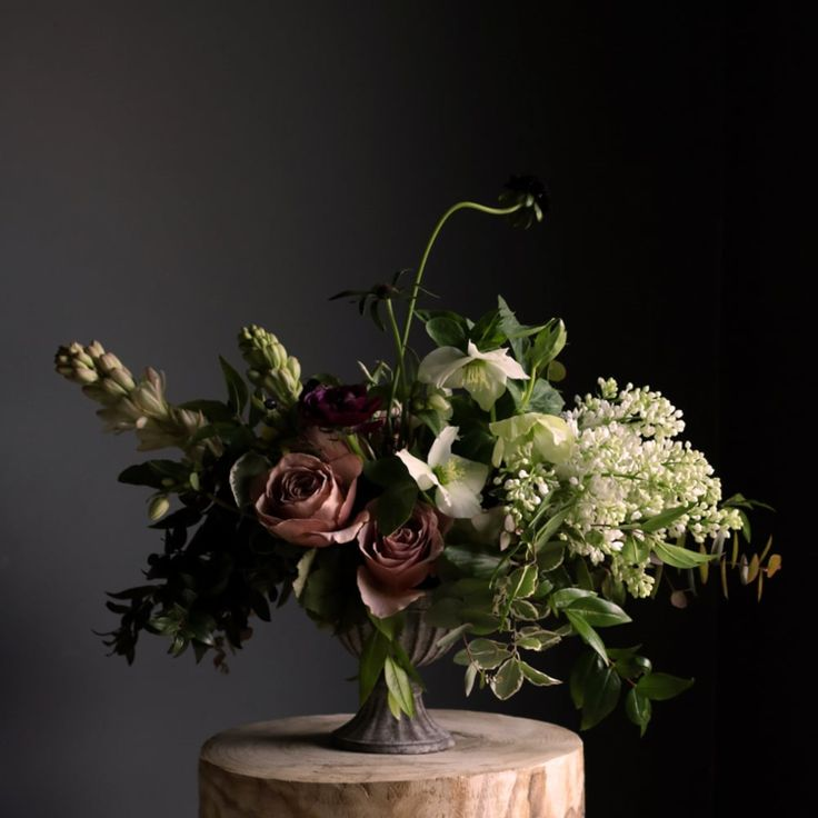 A compote arrangement with Cafe Latte Roses, Lilac, Tuberose, Astrantia, Ranunculus, Hellebore and Scabiosa