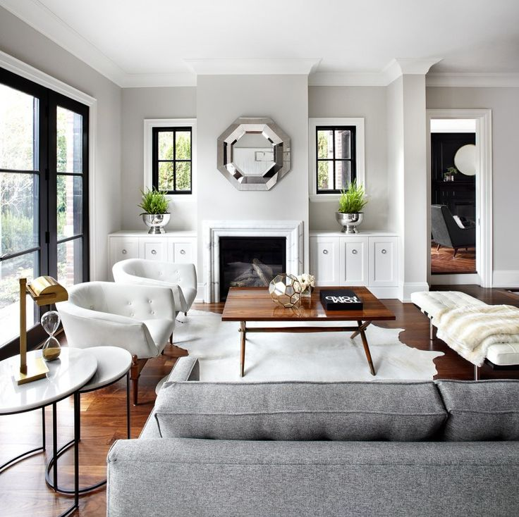 Grey and white living - wood tones, black windows/doors. Love this
