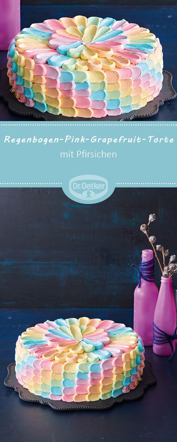 Regenbogen-Pink-Grapefruit-Torte - Torte in Regenbogen-Wisch-Optik mit einer fruchtigen Quark-Pink Grapefruit-Creme und Pfirsichen #rezept #regenbogen #lecker