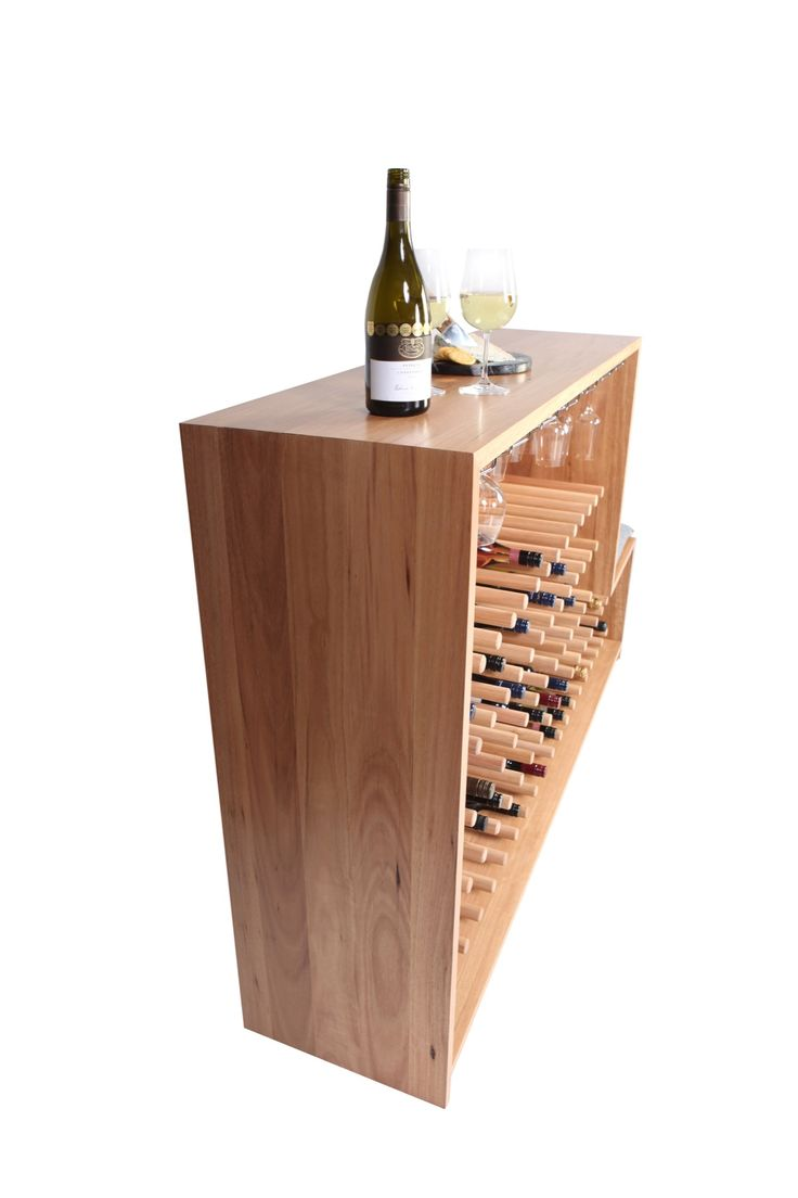 'Vino' is designed to store and display a wine connoisseur's coveted collection on a matrix of cantilevered dowels whilst keeping them close at hand and accessible.  The standard configuration has a storage capacity of 80 bottles and 20 glasses but this can be fully customised to any specification.   #furniture #design #living #style #artwork #art